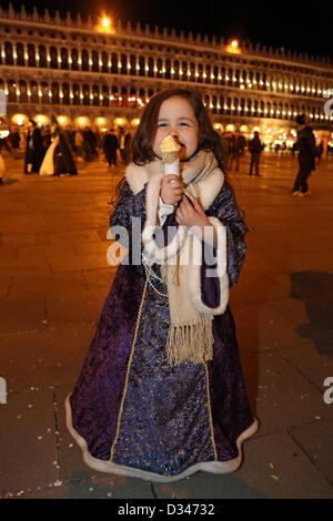 Venice, Italy. 8th February 2013. As the sun begins to set, the beautiful people of the Venice Carnival begin to - Stock Photo