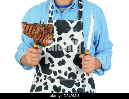 Closeup of a man holding a fork with a barbecued t-bone steak. Man is unrecognizable isolated on a white background. - Stock Photo