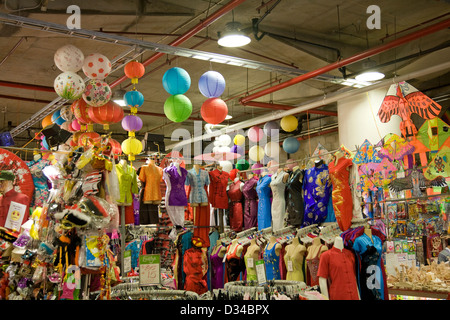 ladies dresses for sale at a stall in paddys markets,sydney - Stock Photo