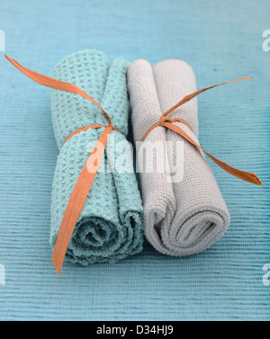 blue wash cloths rolled up for spa treatment - Stock Photo