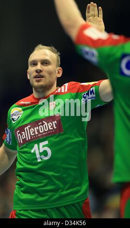Yves Grafenhorst of Magdeburg SC gives cheers for a goal during the  Handball European Cup match SC Magdeburg vs - Stock Photo