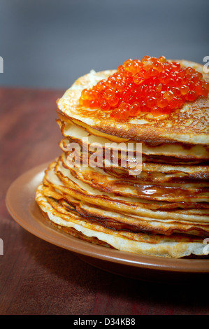 Traditional Russian pancakes with red caviar - Stock Photo