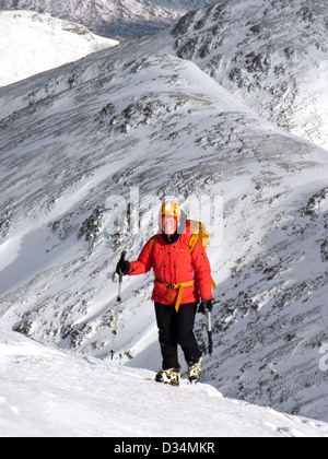 British female mountaineer Adele Pennington on the Scottish mountain Buachaille Etive Beag  in Glencoe in Scotland - Stock Photo
