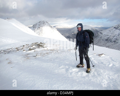 A mountaineer on the Scottish mountain Buachaille Etive Beag  in Glencoe  in Scottish highlands, Scotland UK - Stock Photo