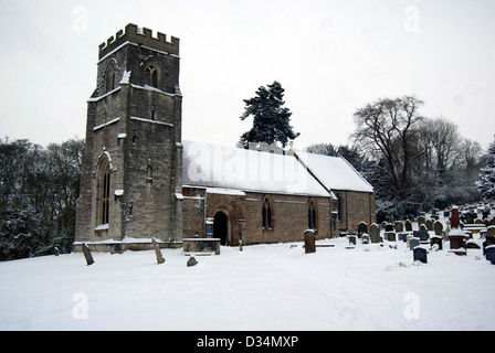 View of St Nicholas Church in Beaudesert, Warwickshire covered in snow - Stock Photo