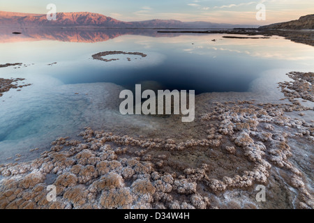 View of the Dead Sea coastline at sunset time - Stock Photo