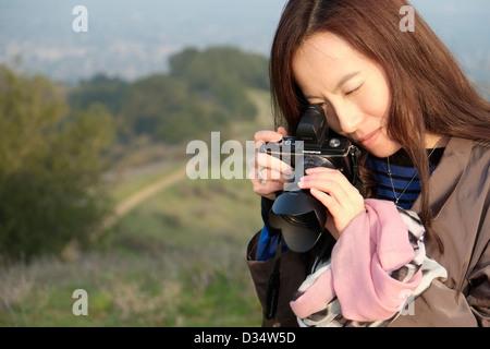 Stylish asian woman with camera - Stock Photo