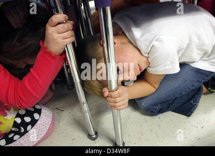Feb. 7, 2013 - Memphis, TN, U.S. - February 07, 2013 - Left to Right Maddie Wolfe, 7, and Hayden Drumwright, 8, - Stock Photo