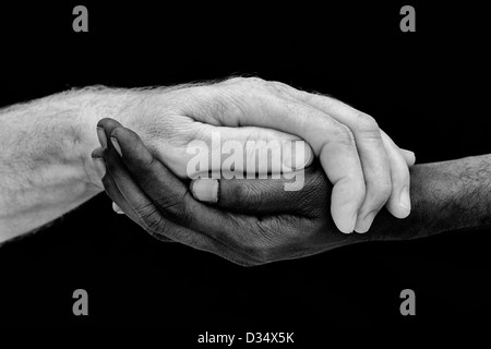 indian and englsih hands. Western and Eastern hands. Black and white. One humanity concept - Stock Photo