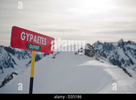 Marker for a red slope at La Mongie, skiing resort of the Grand Tourmalet area in the high Pyrenees, France - Stock Photo