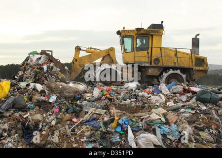 Tractor on landfill site , Dorset UK February - Stock Photo
