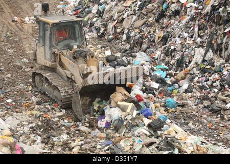 Bulldozer on landfill, Dorset UK Febuary - Stock Photo