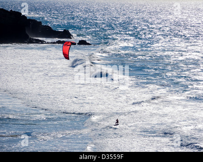 A kitesurfer at the rocky west coast of La Pared, Fuerteventura. - Stock Photo