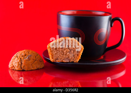Cup of coffee and freshly baked coffee and walnut muffins - Stock Photo