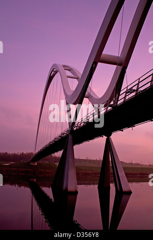 The Infinity Bridge over the river tees at daybreak - Stock Photo