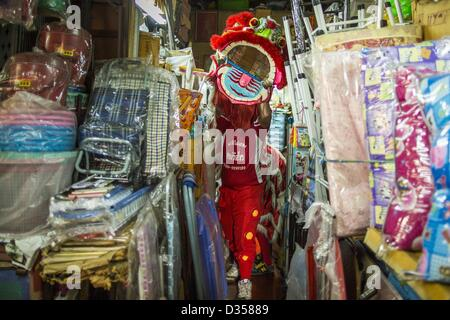 Feb. 10, 2013 - Bangkok, Thailand - A Lion Dancer performs in a market stall on Chinese New Year in the Chinatown - Stock Photo