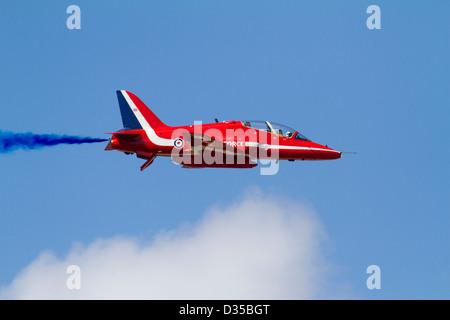 Red Arrow Hawk aircraft in flight - Stock Photo