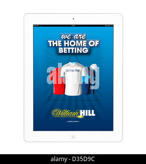 Online betting with the William Hill app on an Apple iPad 4th generation retina display tablet computer - Stock Photo