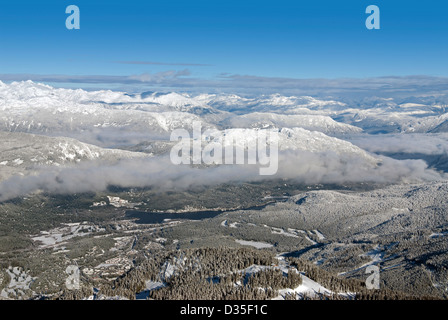Whistler Village and Coast Mountains in winter - Stock Photo