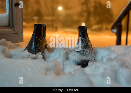 Feb. 9, 2013  Merrick, New York, U.S. -  Blizzard Nemo hits Long Island South Shore communities. Men's empty boots - Stock Photo