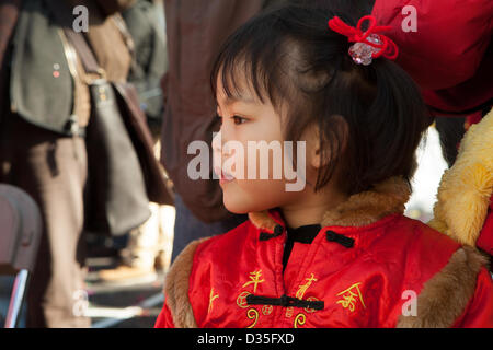 New York City, US, 10 February 2013. A girl in the crowd wears a traditional embroidered red jacket as New York's - Stock Photo