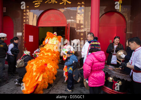 New York City, US, 10 February 2013. A lion enters the Eastern Buddhist Association's East Dhyana Temple on Division - Stock Photo