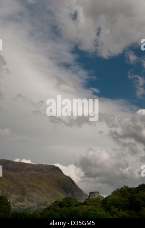 Dolbadarn Castle, Llanberis, Wales, against a blue and white cloud sky. - Stock Photo