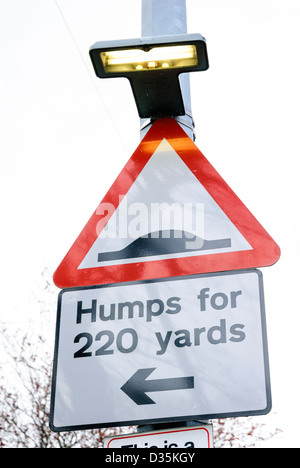 Sign warning of traffic calming measures - Stock Photo