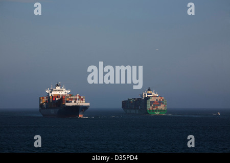 Two Panamax class Container Ships arriving and departing at Port Botany Sydney Australia - Stock Photo