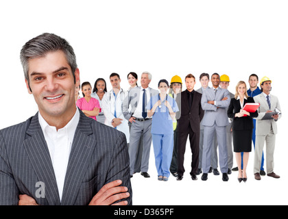 Smiling businessman ahead a group of people with different jobs - Stock Photo