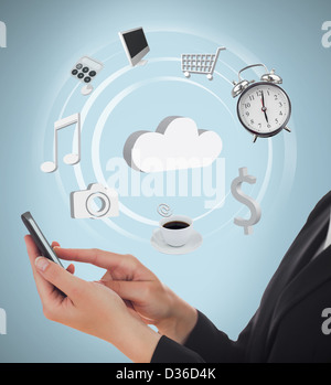Businesswoman using applications on mobile phone - Stock Photo