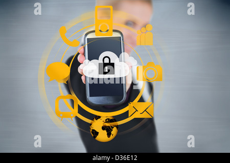 Businesswoman holding up locked smart phone with orange applications - Stock Photo
