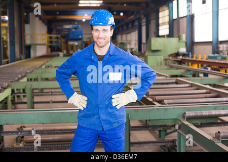 Construction worker with helmet in assembly hall - Stock Photo