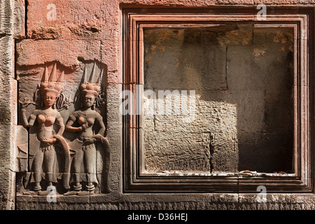 Religious carving showing Aspara nymphes and empty frame for editing - Stock Photo