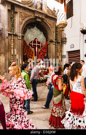 Women in traditional dress during Day of the Cross festival at the Convent of the Comendadoras de Santiago in Granada, - Stock Photo