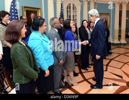 US Secretary of State John Kerry discusses his commitment to a diverse workforce with State Department employee - Stock Photo