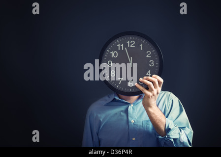 Businessman with black clock in front of his head, deadline concept. Not enough time to finish the job. - Stock Photo