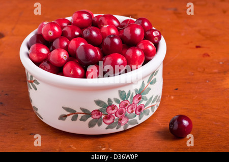 Ripe cranberries in a pottery dish. - Stock Photo