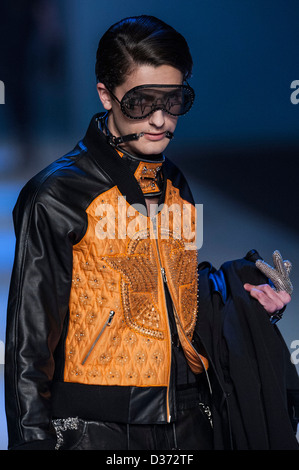 A model showcases designs on the runway by Cheung Hiu Ha Hera's Artificial - Invade show during the Hong Kong Fashion - Stock Photo