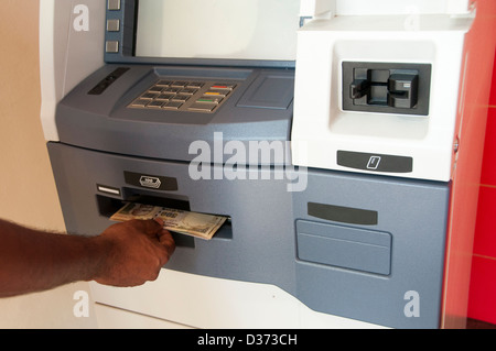 Withdrawing cash from ATM - Stock Photo
