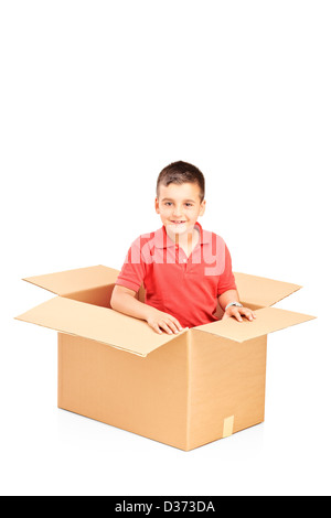 A smiling child in a cardbox isolated against white background - Stock Photo