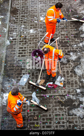 Municipal cleaning services, after a carnival parade, cleaning the street. - Stock Photo