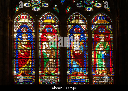 Medieval Gothic stained glass window showing the Kings of France. The Gothic Cathedral Basilica of Saint Denis - Stock Photo
