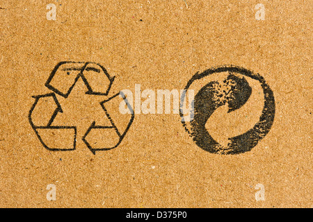 the cardboard with recycling symbol - Stock Photo