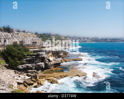 A portion of the Bondi to Coogee Walk with sea and waves on a sunny day. - Stock Photo