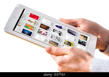 Person is using a tablet computer. Itunes, music. - Stock Photo
