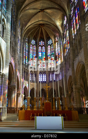 Medieval Gothic stained glass window in the choir  of Saint Denis. Cathedral Basilica of Saint Denis Paris - Stock Photo
