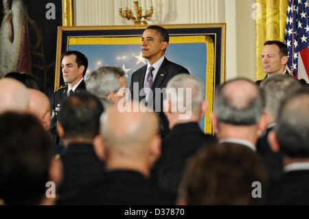 US President Barack Obama stands at attention with Army Staff Sergeant Clinton Romesha after presenting him the - Stock Photo