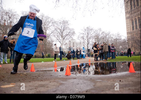 London, UK. 12th February 2013. – the 16th Parliamentary Pancake Race takes place next to the Houses of Parliament - Stock Photo