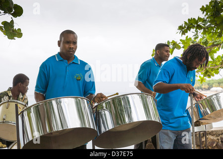 Steel band playing on the beach in St Lucia, West Indies. - Stock Photo